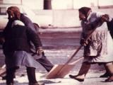 Babushki shoveling snow